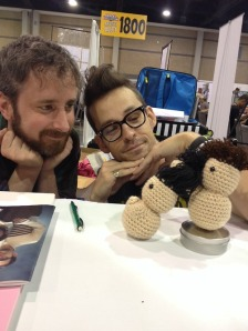 The creative team with fan-made, crocheted brimpers.