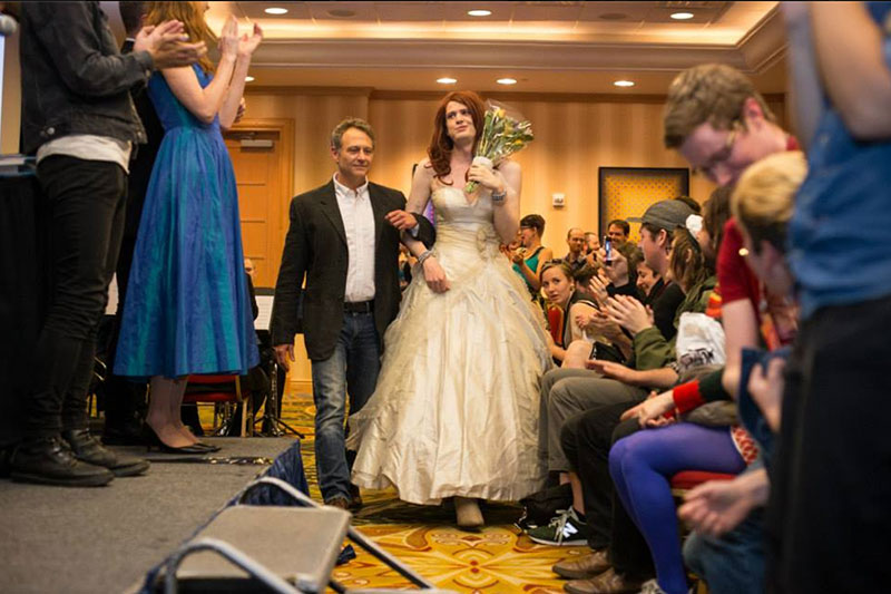 Hanselmann as the blushing bride, escorted by Gary Groth.